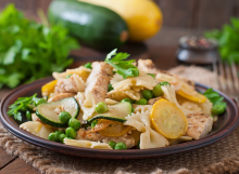 Pasta with zucchini, chicken and green peas